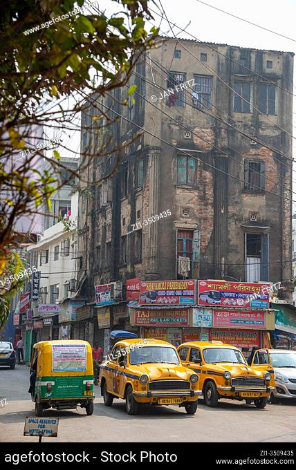 city centre with yellow cabs and tuk tuks in Calcutta, India