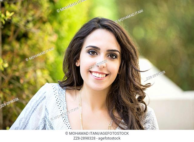 Happy young woman smiling outdoors