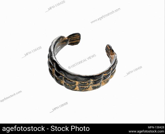 Glass bracelet. Period: Late Imperial; Date: ca. 4th-5th century A.D; Culture: Roman; Medium: Glass; drawn and tooled; Dimensions: Overall: 15/16 x 2 11/16in