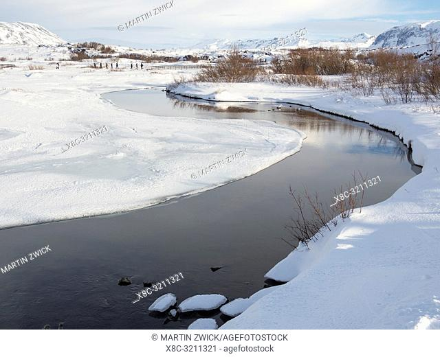 River Oexara. Thingvellir National Park covered in fresh snow in Iceland during winter. Thingvellir is part of UNESCO world heritage