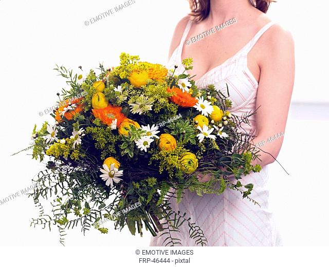 Bouquet of marigold, buttercups and marguerites