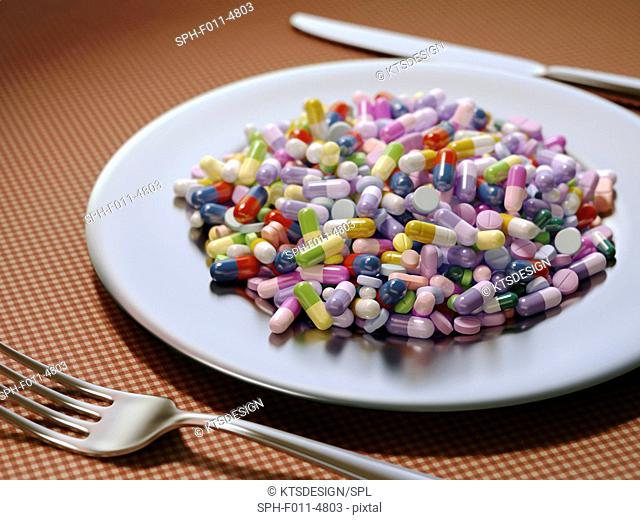 Plate covered in pills and capsules