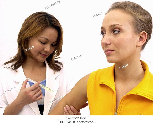 Young woman getting vaccination