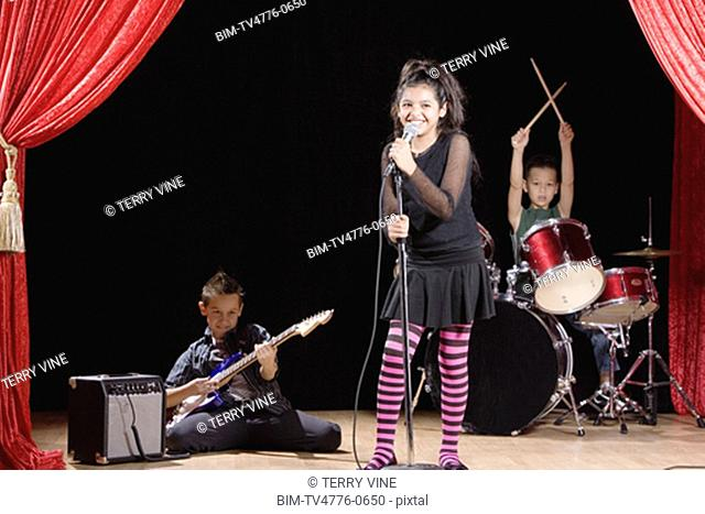 Multi-ethnic children performing in band