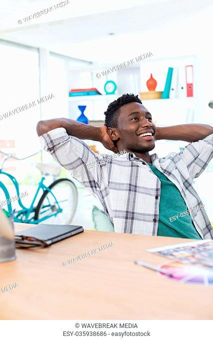 Male executive relaxing at his desk