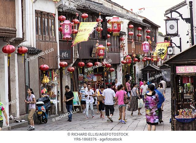 Shops and tourists in the Shantang Road area in Suzhou, China