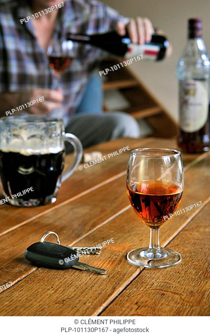 Car key and man pouring alcohol