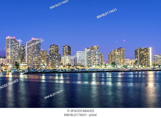 Honolulu city skyline reflection in ocean, Hawaii, United States