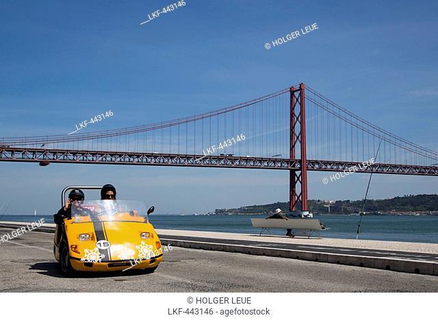 GoCar on the seafront promenade near Ponte 25 de Abril bridge over Tagus river, Lisbon, Lisboa, Portugal