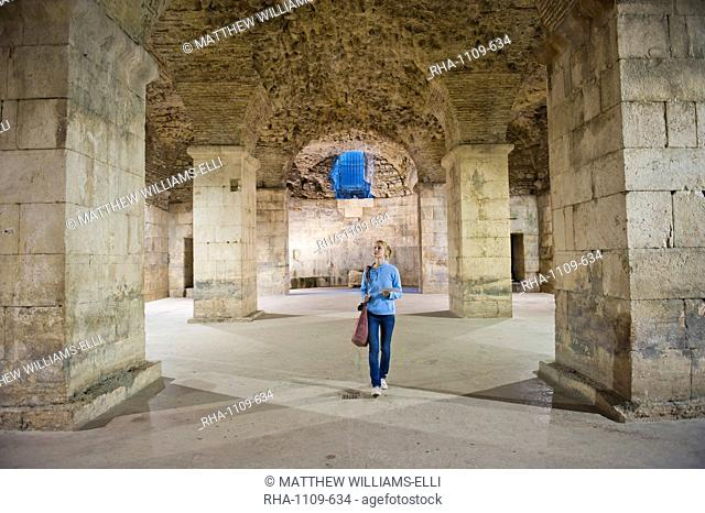 Tourist exploring the underground halls at Diocletian's Palace, UNESCO World Heritage Site, Split, Dalmatian Coast, Croatia, Europe