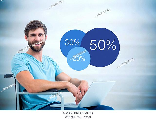 Man in wheelchair with laptop and blue statistics against blurry blue wood panel