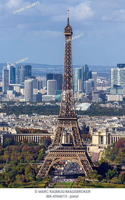 Eiffel tower in front of high-rise La Défense quarter, Paris, France