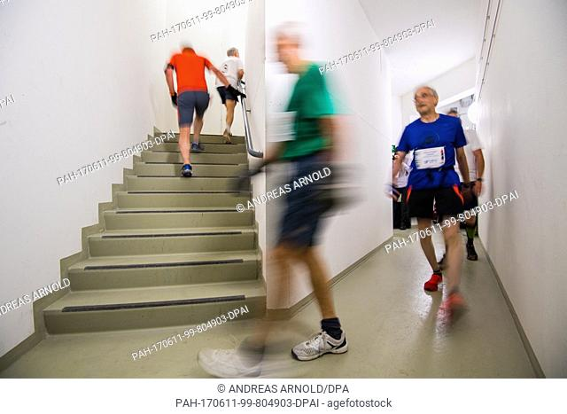 Runners race up a flight of stairs in Frankfurt am Main, Germany, 11 June 2017. Over 1000 runners took on 1202 stairs and 222 metres of height in several...