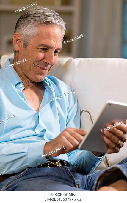 Caucasian businessman using digital table