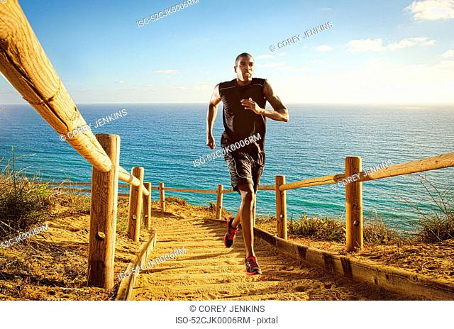 Man running on dirt path