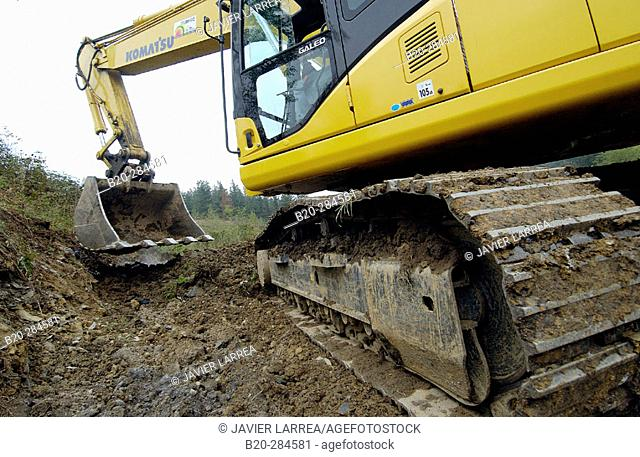 Construction of forest trail with black slag from foundry. Ormaiztegi, Guipúzcoa. Euskadi, Spain