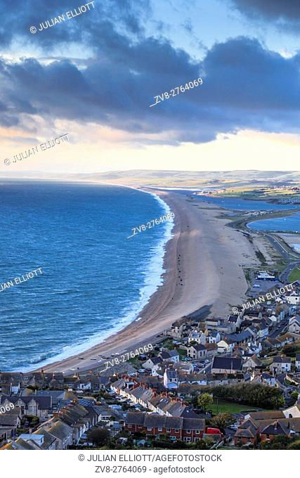 The evening light side-lights the long Chesil Beach between Weymouth and Portland in Dorset