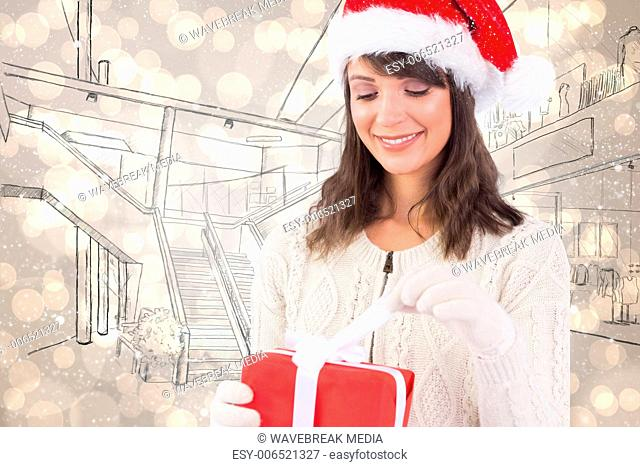 Composite image of festive brunette opening a gift