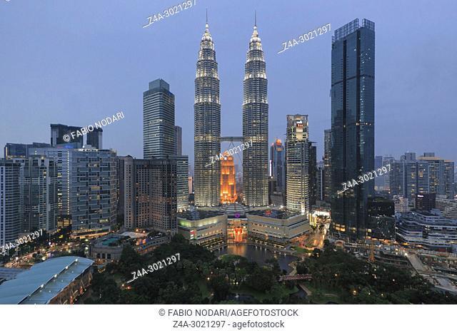 Cityscape of Kuala Lumpur at sunset with Petronas Towers