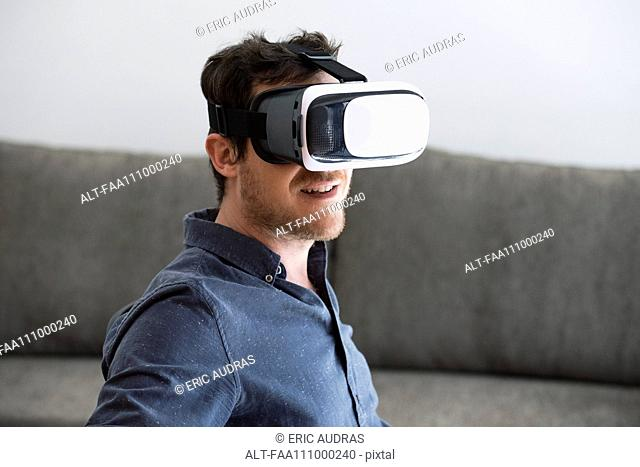 Mid adult man using virtual reality headset