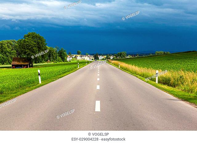 View of countryside road after thunder storm, near Schaffhausen Switzerland