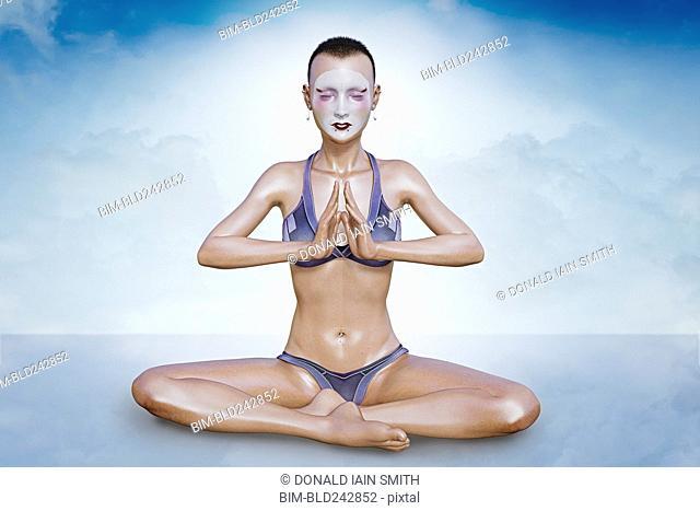 Woman wearing face paint meditating