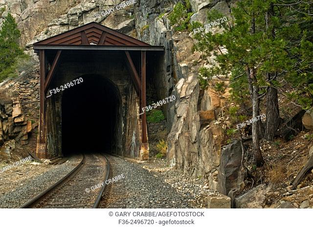 Train tunnel through mountains along the Trans-Sierra Railroad near Emigrant Gap, California