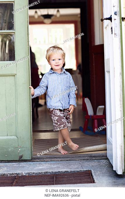 Boy standing in doorway