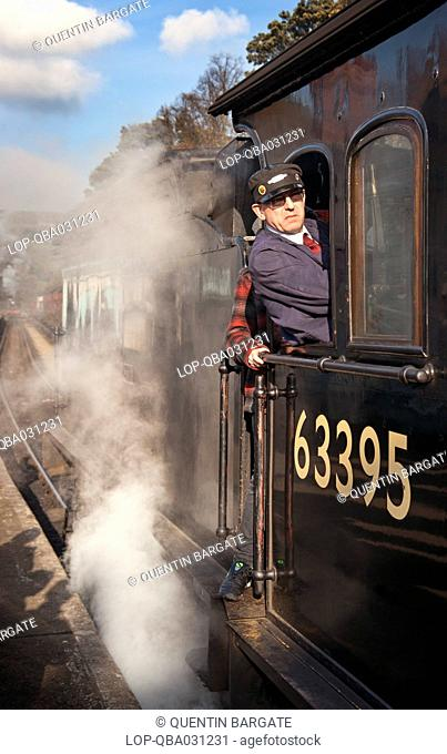 England, North Yorkshire, Grosmont. Steam Train and driver at Grosmont station on the North Yorkshire Moors Railway