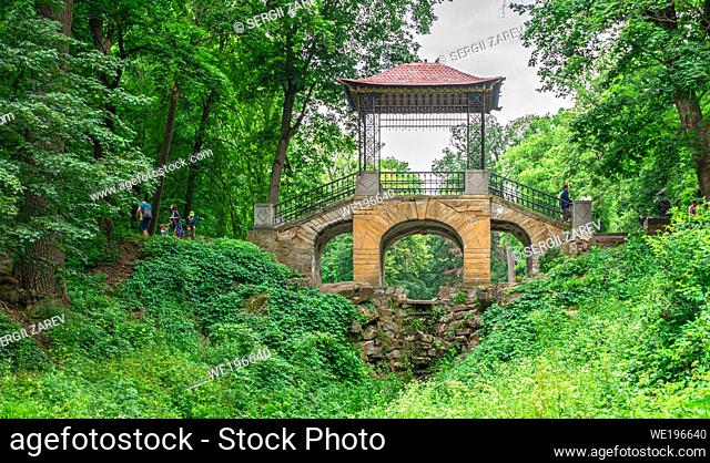 Bila Tserkva, Ukraine 06. 20. 2020. Chinese bridge in the Alexandria park, one of the most beautiful and famous arboretums in Ukraine, on a cloudy summer day