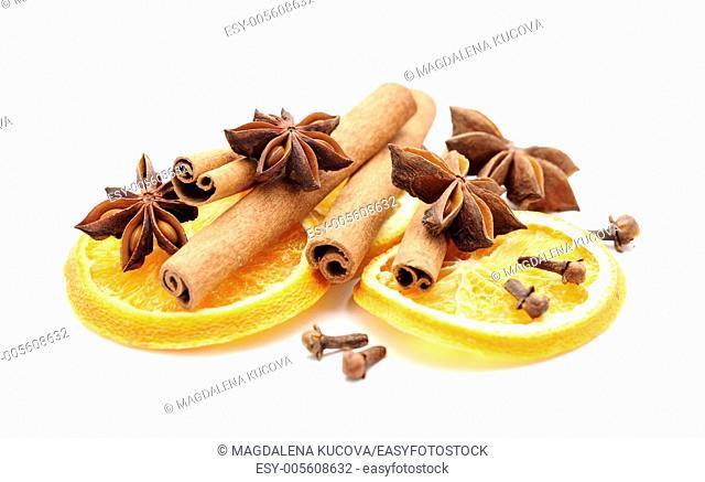 Dry orange slices, cinnamon sticks, anise and clove on white background