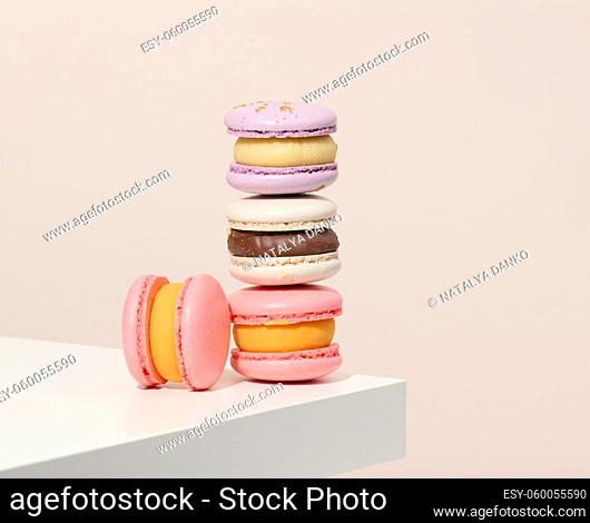 baked round macarons on a white table, delicious dessert