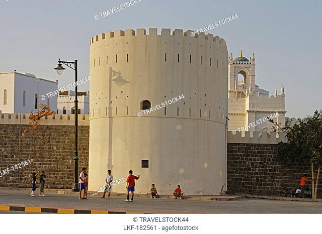 Oman Muscat Government district in old city center kids playing in front of tower