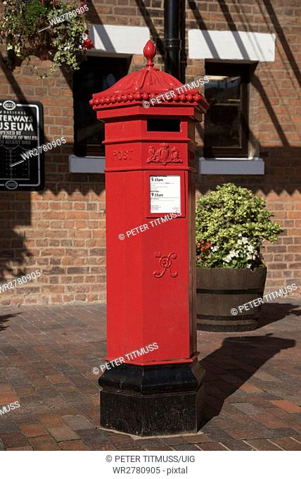Red Letter box, A Royal Mail freshly painted letter box which dates from the reign of Queen Victoria situated at Gloucester Docks England UK