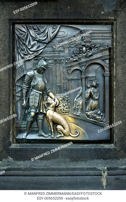 Bronze Relieff on the Charles Bridge in Prag.Statue of St.John Nepomuk.Das rub the dog supposed to bring luck
