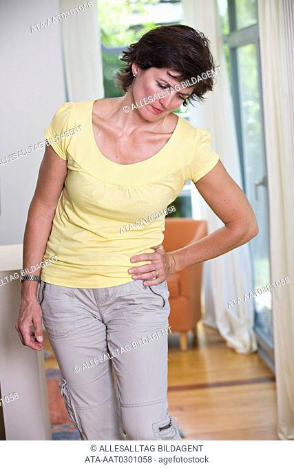 Woman suffering from hip pain