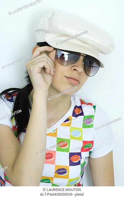 Teenage girl wearing sunglasses and cap, portrait