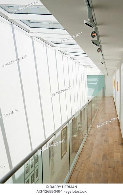 Double height hallway and glass balustrade