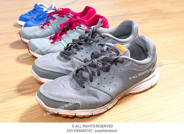 Three pairs of sneakers for the whole family, dad, mom and child