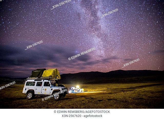 Land Rover with camp set up beneath the Milky Way in Sani Pass, Lesotho, Africa