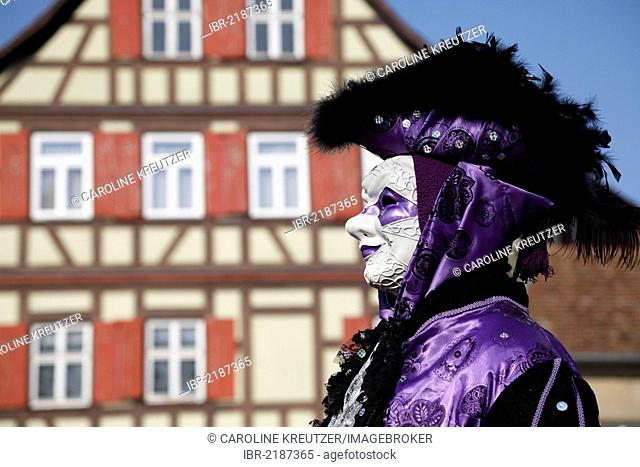Man wearing a mask standing in front of half-timbered house, Hallia Venezia carnival, Schwaebisch Hall, Baden-Wuerttemberg, Germany, Europe