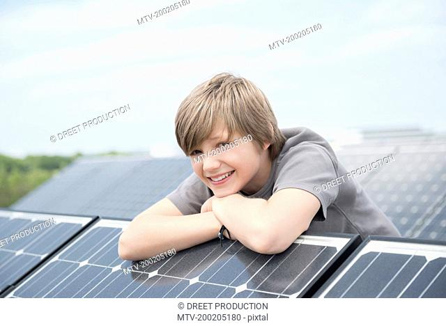 Close up portrait boy Photovoltaic panel