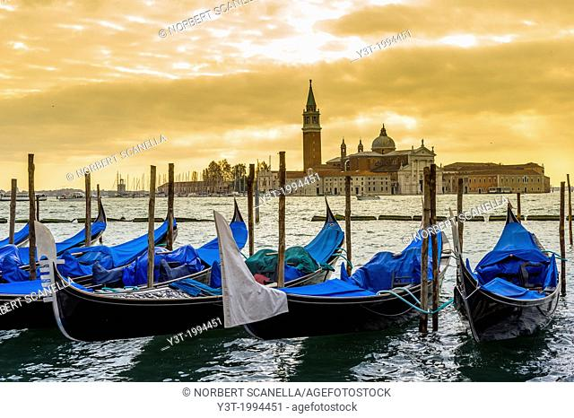 Europe, Italy, Veneto, Venice, classified as World Heritage by UNESCO. Gondola and the church San Giorgio Maggiore at sunset
