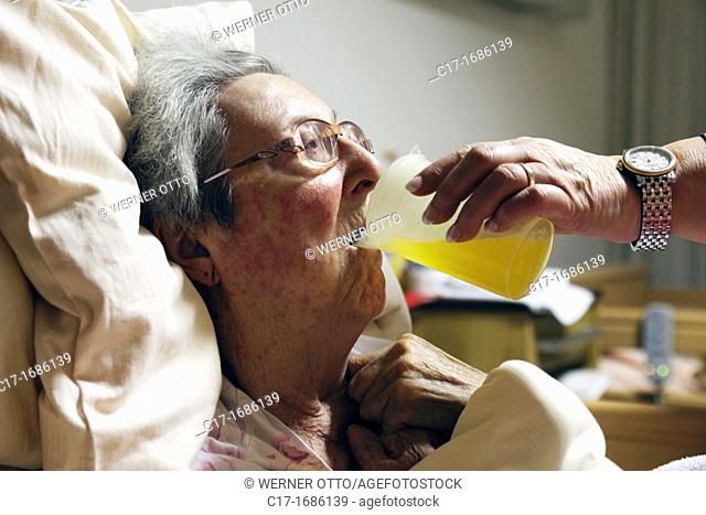 people, old age, retirement home, Altenzentrum der St Clemens Hospitale in Sterkrade, older woman lies in a sickbed, aged 70 to 85 years, physical handicap