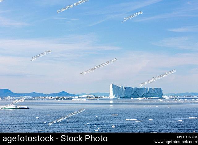 Melting polar ice over sunny blue Atlantic Ocean Greenland