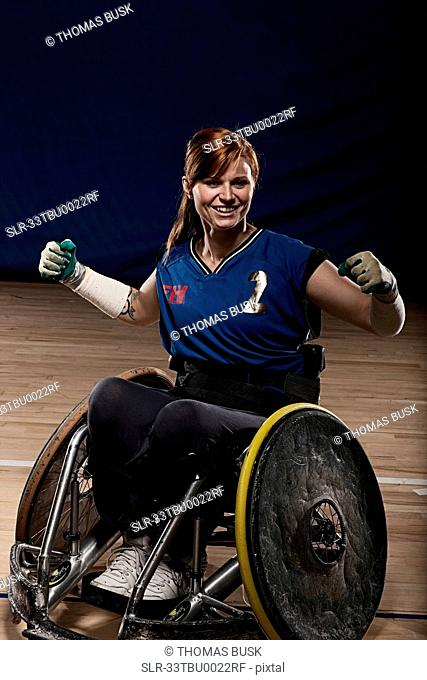 Para rugby player cheering in wheelchair