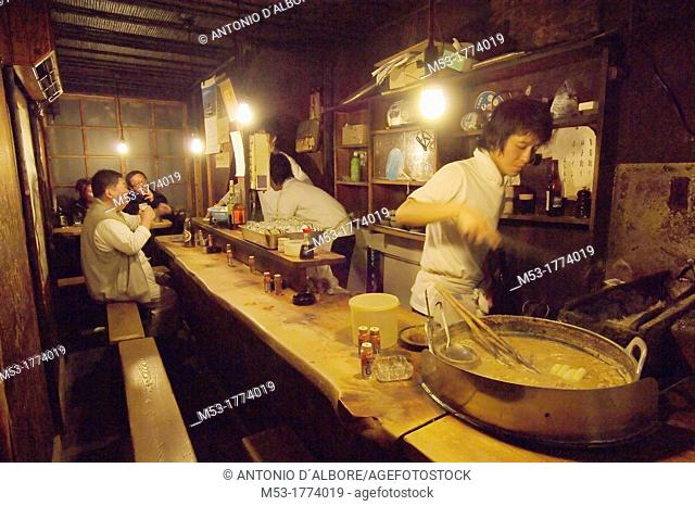 japanese people enjoy soup and beer in a traditional restaurant  shinjuku district  tokyo  tokyo to  kanto region  japan