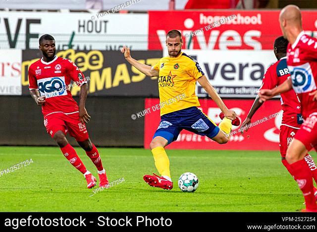 Kortrijk's Teren Moffi and Waasland-Beveren's Aleksandar Vukotic fight for the ball during the Jupiler Pro League match between KV Kortrijk and Waasland-Beveren
