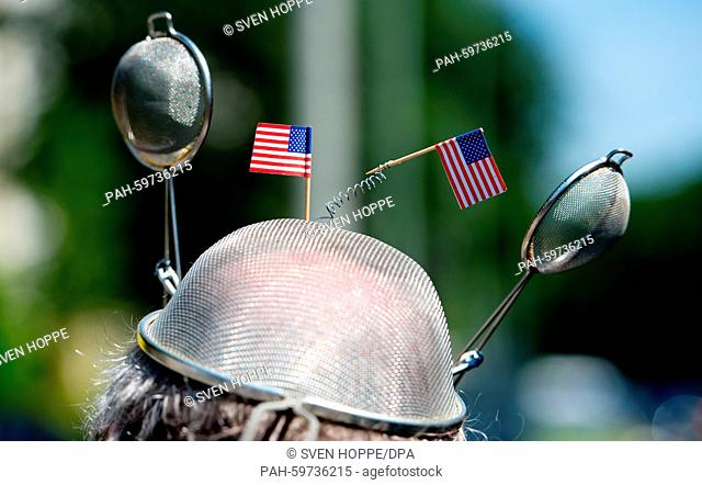 A members of Amnesty International protests on occasion of the Independence Day in front of the US consulate as he holds a self-made 'listening device' in...
