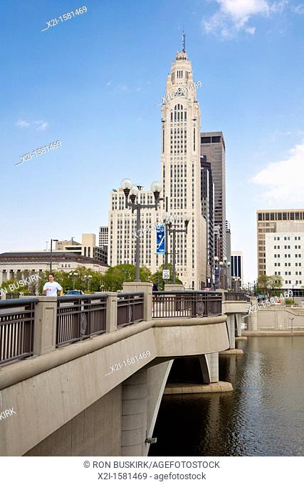 Cityscape of downtown Columbus, Ohio as seen from foot of Broad Street Bridge across the Scioto River